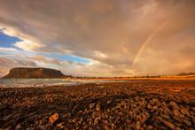 Scenic ,rainbow ,over Ogilvey Beach, Stanley. The Nut A Volcanic Plug In The Distance. North West Coast Of Tasmania, Australia.