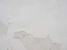 White Wall With Peeling Pieces Of The Wall.