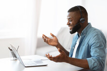Web Conference. Friendly Black Guy In Headset Making Video Call On Laptop