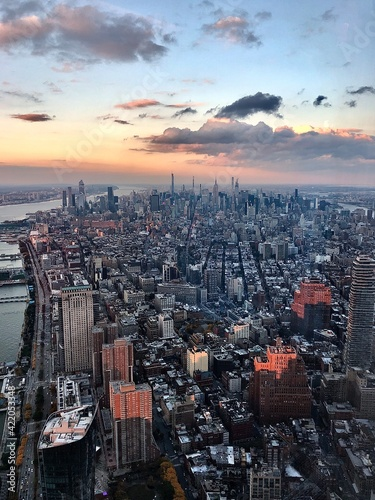 Obraz na plátne Aerial View At Sunset Of The Island Of Manhattan Looking Uptown And The Hudson River To The East