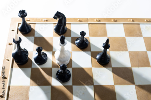 Photographie Board game chess with chess pieces in front of white background