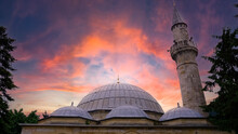 Dome And Tower Of Public Muslim Mosque Under The Cloudy Sky Background. Historical Mosque In Anatolian Lands. Mosque With Beautiful White Domes On Minarets. Islamic Mosque Design. Place Of Worship.
