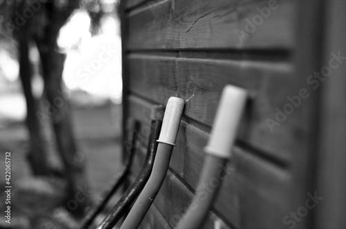 Canvas Close-up Of  Wheelbarrow Against Wall