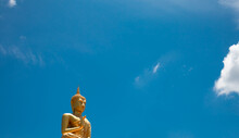 Statue Of Buddha Against Blue Sky
