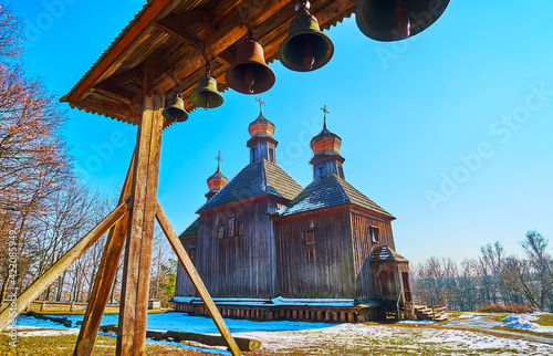 Canvas The view of St Michael Church and its belfry on the wooden crossbar, Pyrohiv Ska