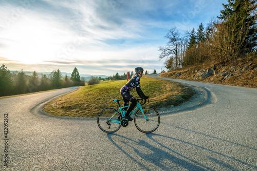 Obraz Women cycling on the mountain road   - fototapety do salonu