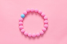 Top View Of Soft Pom Pom Balls Forming A Circle On Pink Background