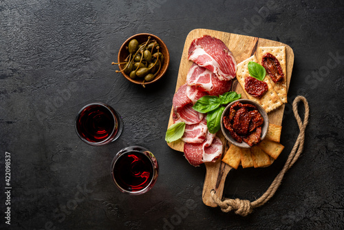 Fotografie, Obraz Appetizers with differents antipasti, charcuterie, snacks and red wine