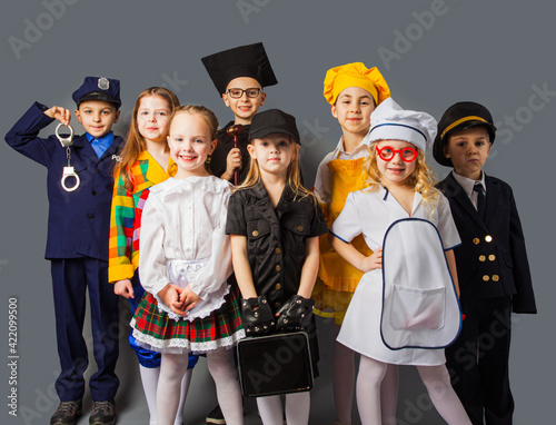 Little kids dressing up as professions. Future education
