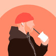 Guy with earphones drinking shake