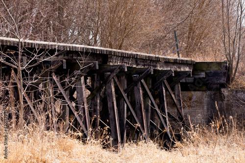 Leinwand Poster wooden train trestle bridge in the woods