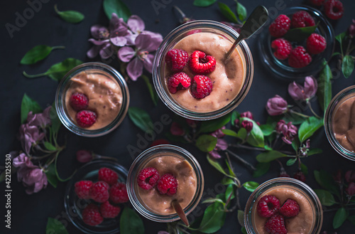 Fototapeta Velvety Cocoa and raspberry pudding with a hint of cinnamon served in a Mason Jar. Gourmet dessert. Spring composition. French cuisine. obraz