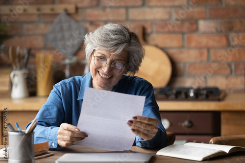 Fotografia, Obraz Happy retired hispanic woman bank client hold official document notification informing loan mortgage is paid