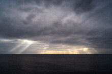 Sun Rays Make Their Way Through Dramatic Clouds. Weather Turns Bad In The Evening. Beautiful Seascape