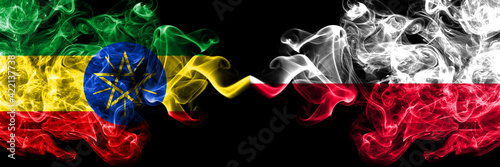 Fototapeta Ethiopia, Ethiopian vs Poland, Polish, Pole smoky mystic flags placed side by side. Thick colored silky abstract smoke flags. obraz