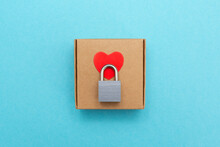 Heart Lock. Self-gathering Cardboard Box. Delivery, Moving, Gift Wrapping On A Colored Background.