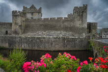 12th Century Cahir Castle With Moat In Cahir Town With Dramatic, Storm Sky In Background, County Tipperary, Ireland