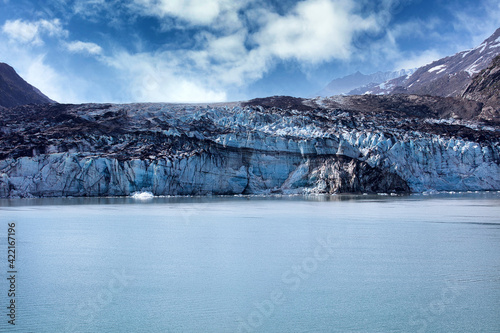 Fototapeta Alaska Glacier entering water with global warming and climate change melting the