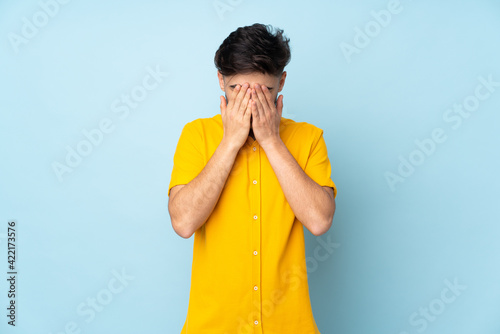 Arabian handsome man over isolated background with tired and sick expression Wallpaper Mural