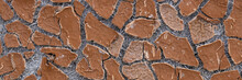 Texture Of Old Cracked Artificial Leather. The Surface Of The Dried Leatherette With Lots Of Cracks And Pieces Of Brown Material. Faux Leather Texture. Wide Panoramic Background For Design.