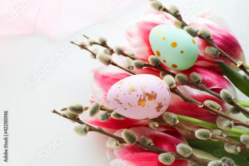 Fototapeta Easter greeting card. Easter eggs, flowers and willow twigs  obraz na płótnie