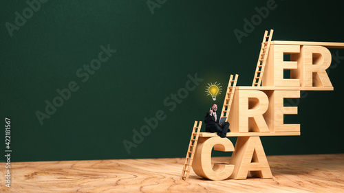 businessman thinking about his career in front of the word CAREER formed as a stair on wooden base and blackboard background