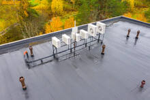 Flat Roof With Waterproofing Concept Housetop Covering With Waterproofing. Air Conditioners On Flat Roof. Flat Roof Is Covered With Waterproofing Material. Housetop Of A Large Building From A Height