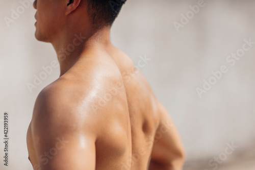 Fotografie, Obraz Rear view of muscular athletic young man