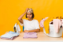 Young Hispanic Woman Ironing Clothes Isolated Being Shocked, She Has Remembered Important Meeting.