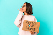 Young Hispanic Mixed Race Woman Holding A Protect Our Planet Cardboard Shouting And Holding Palm Near Opened Mouth.