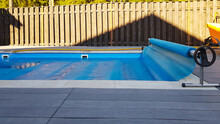 Swimming Pool Cover For Protection Against Dirt, Leaves, Heating And Cooling Water