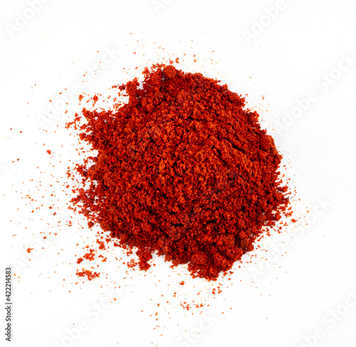 Obraz na plátně Heap red chili powder or paprika on a white background, top view