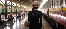 LGBT Transgender Model Travels On Train At Station Railway