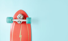 Minimal Red Surf Skate Or Skateboard On Blue Color Background. Sport Activity Lifestyle Concept, Copy Space.