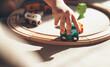Leinwandbild Motiv caucasian kid is playing with toy train on the railway on the floor