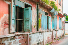 Pink Building Old Vintage Style Decorated With Blue Windows And Dirty Stains. Architecture, Accommodation, Photos