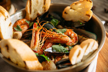 Closeup On Assorted Seafood Basket Bowl With Toasted Bread