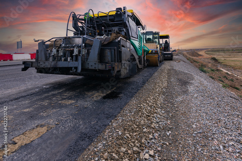 Fototapeta Asphalt machine at the construction site of a road obraz