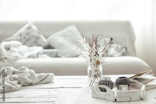 Fototapeta Home arrangement with candlesticks, twigs in a vase and Scandinavian decor details. obraz