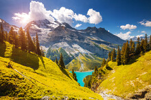 Spectacular View Of The Lake Oeschinensee In Sunny Day. Location Place Swiss Alps, Kandersteg District, Europe.