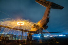 Fireworks On An Abandoned Plane. Fire Show On The Plane. Airplane Photos And Images