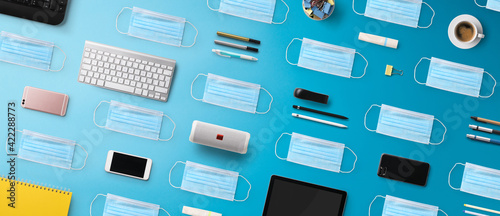 Obraz Flat lay top view desk working space with face mask, home office and coronavirus concept. - fototapety do salonu