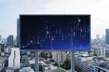 Forex and stock market chart hologram on road billboard over panorama city view of Bangkok. The financial center in Southeast Asia. The concept of international trading.
