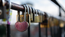 Heart-shaped Padlock Locked On The Fence