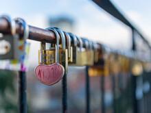 Heart-shaped Padlock Locked On The Fence