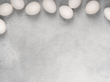 Fresh White Chicken Eggs, Top View, On A Gray Background. Healthy Eating.
