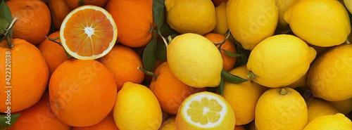 Fototapeta Background from ripe oranges and lemons. obraz