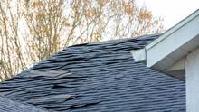 Old Asphalt Roof Shingles On House Roof
