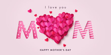 Happy Mothers Day Banner. Holiday Background With Big Heart Made Of Pink And Red Origami Hearts On Soft Pink Background With Paper Cut Mom Text. Design For Fashion Ads, Poster, Flyer, Card, Website
