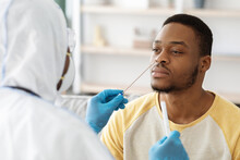 Black Guy Receiving Nasal PCR Test While Staying Home